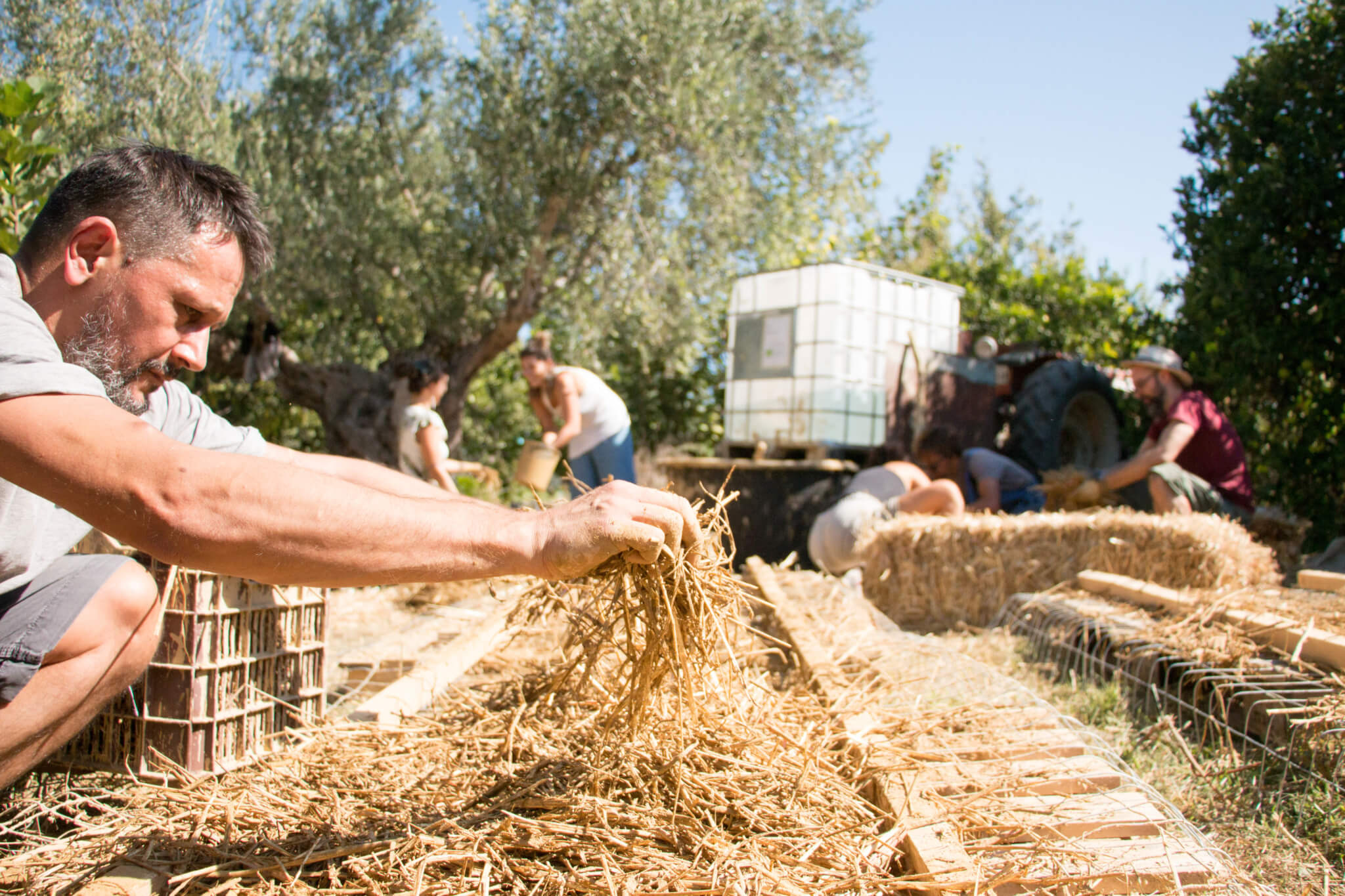 putting the straw for natural building
